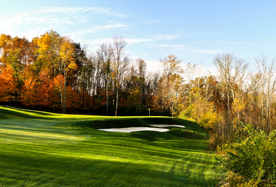 The sun shines on one of the holes at Country Club of the North